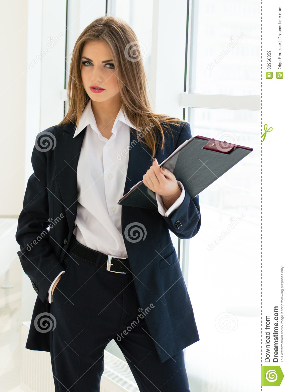 Businesswoman In Man S Suit Amp Shirt Writing With Pen At