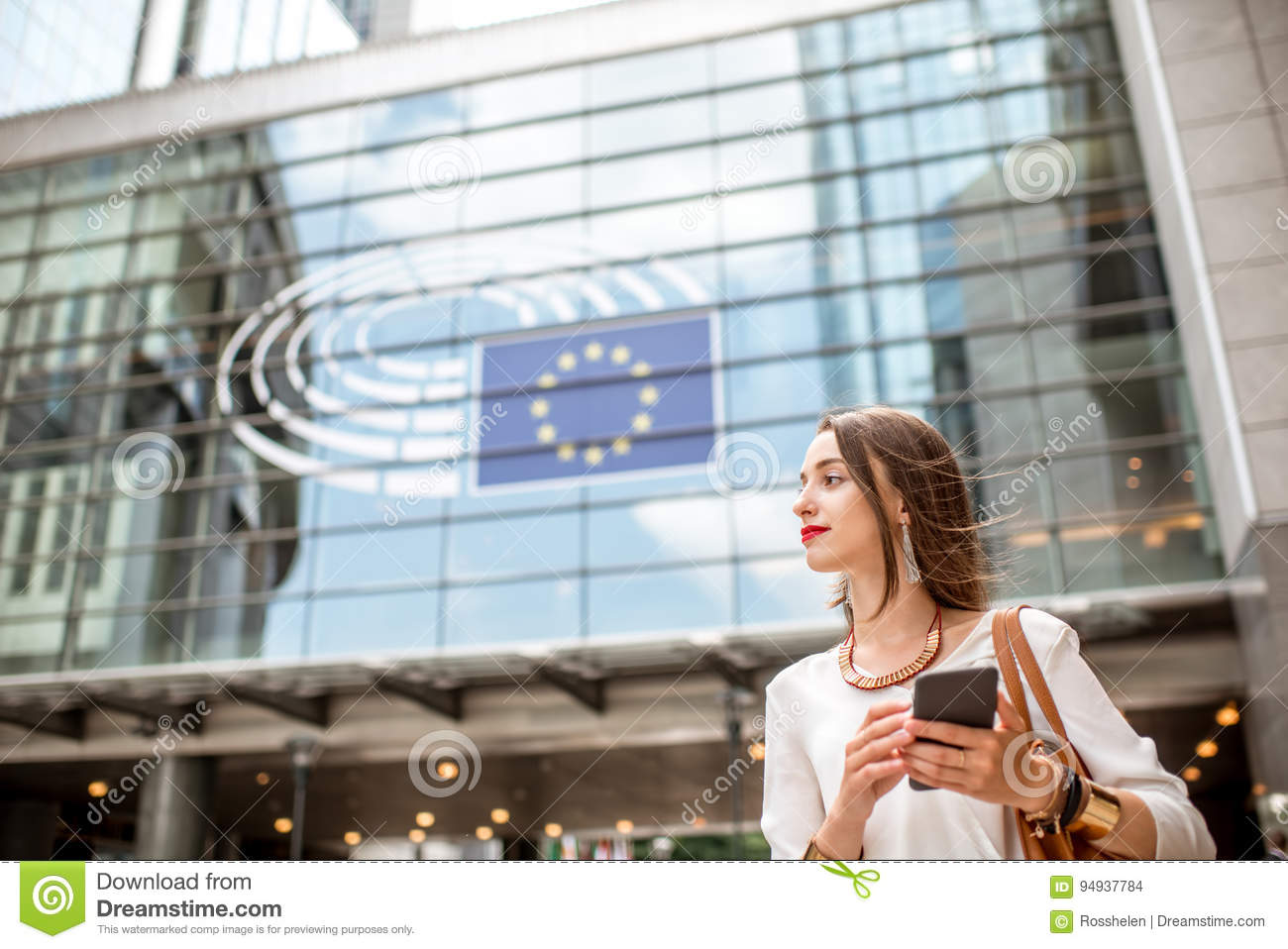 Businesswoman near the parliament building in Brussel