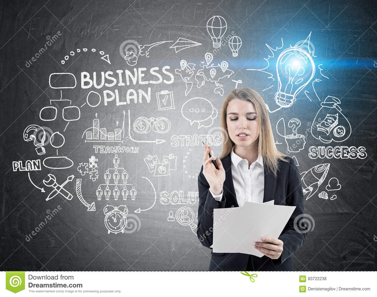 Businesswoman With Papers And Business Plan Sketch Stock Photo