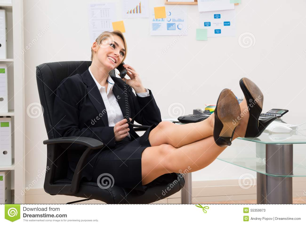On The Phone With Feet On Desk Stock Photo - Image: 55359973