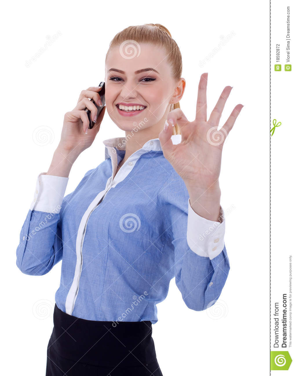 Businesswoman with phone and ok gesture