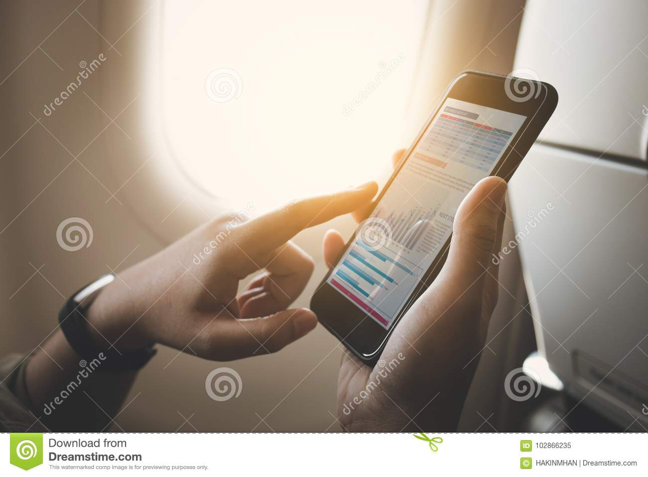Download Businesswoman On Plane Using Smartphone With Graph On Screen.Business Technology Stock Image - Image of female, holiday: 102866235