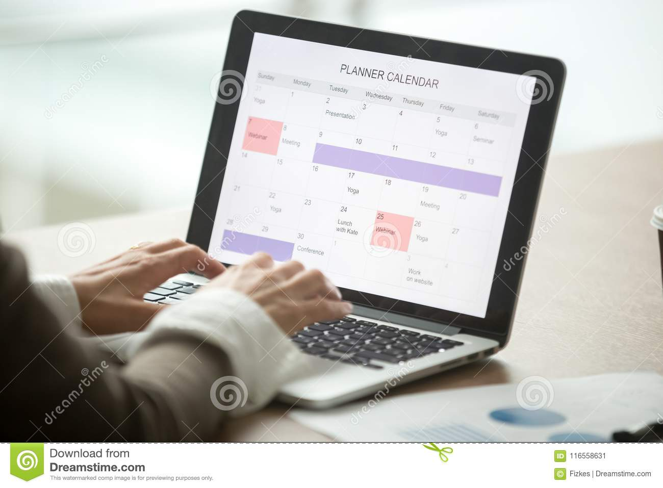Calendar Planner For Laptop : Businesswoman planning day using digital calendar on