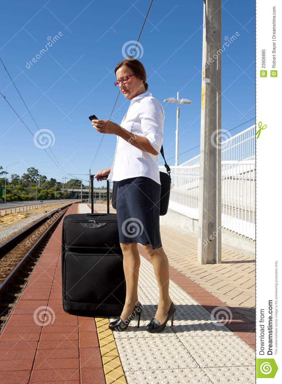 Businesswoman ... - Businesswoman On Platform At Train Station Royalty Free Stock