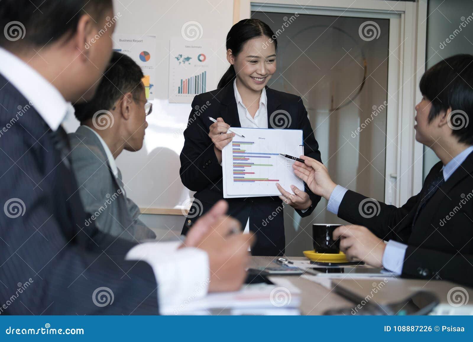 Businesswoman present financial plan report to co worker team. w