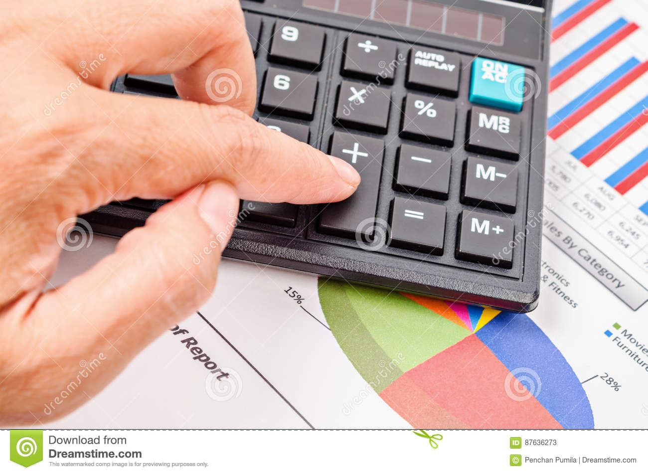 businesswoman press calculator button on sales report document