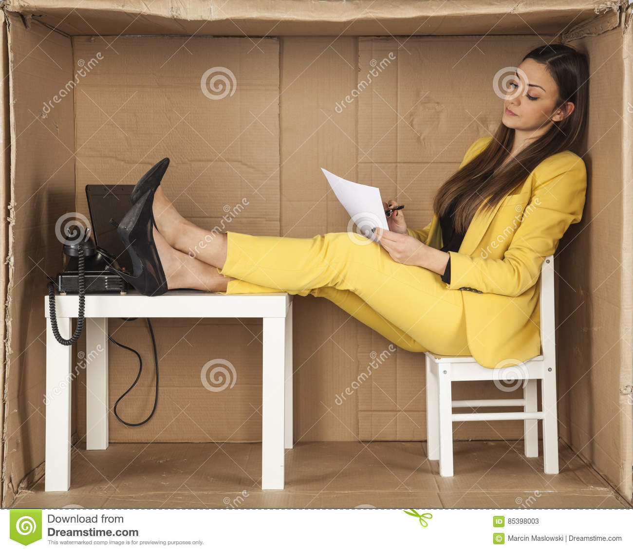 Businesswoman Reads Documents And Keeps His Feet On The