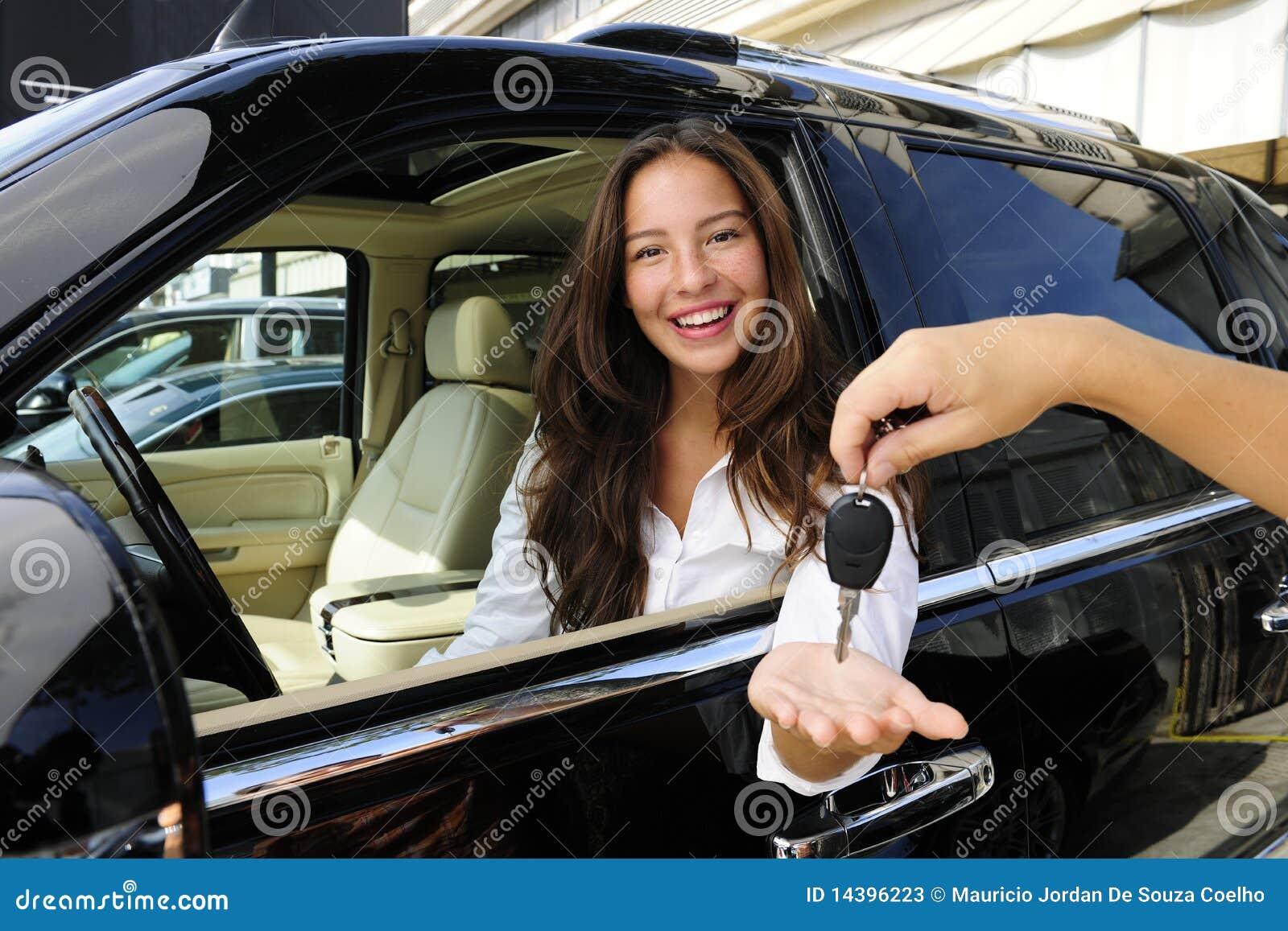 Businesswoman receiving keys of new car