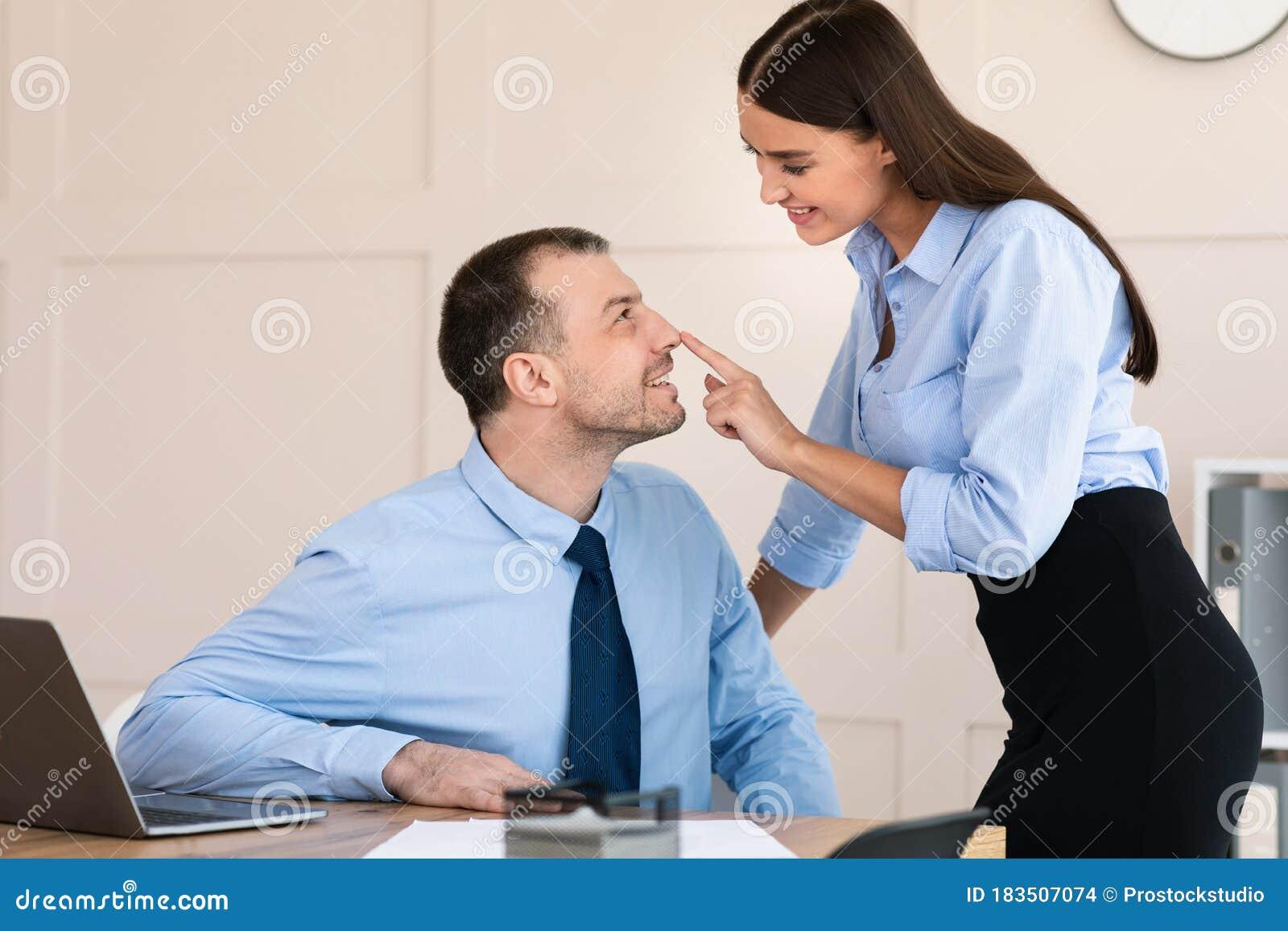 Businesswoman Seducing Male Employee Flirting At Workplace