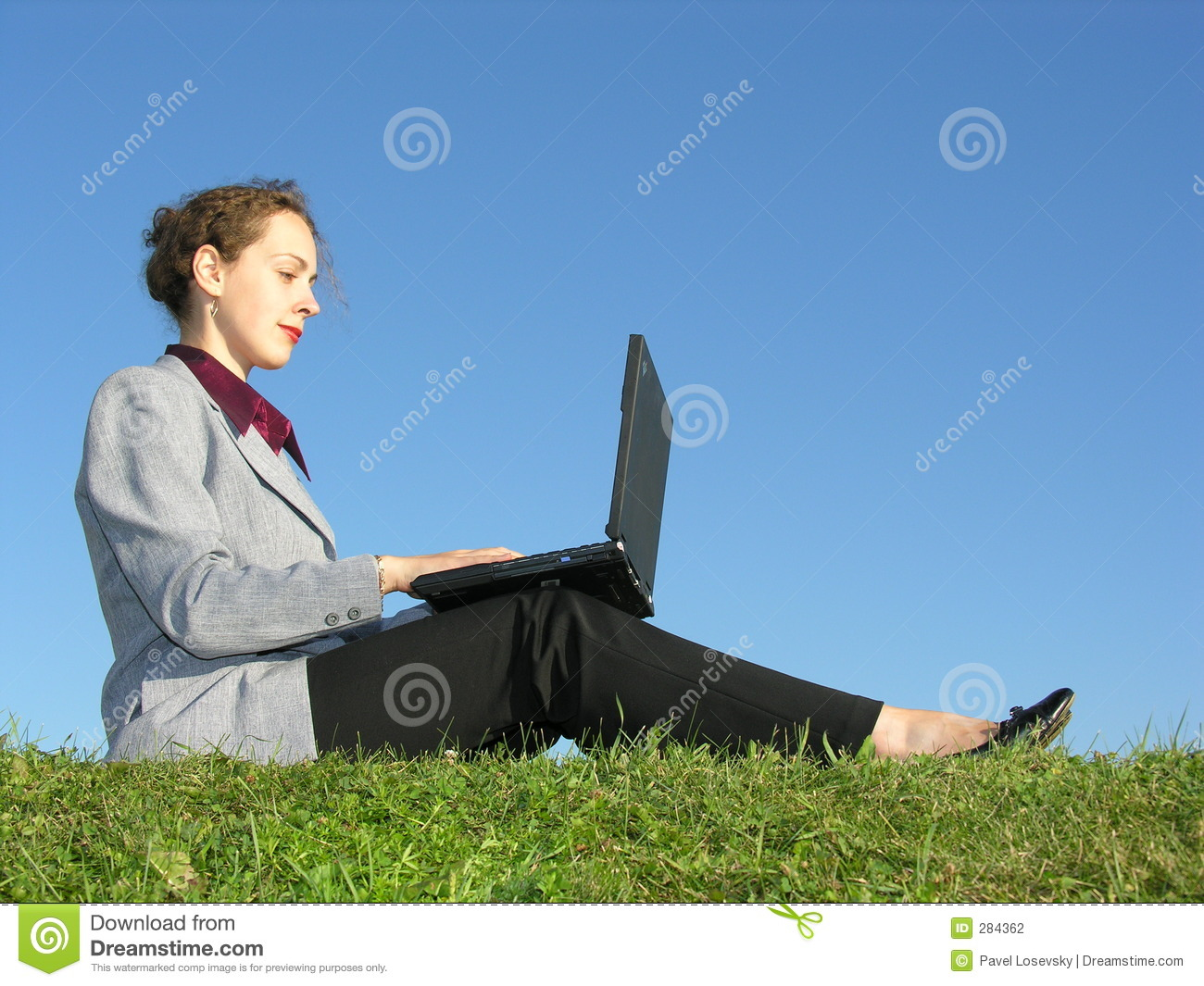 Businesswoman sit with notebook on blue sky