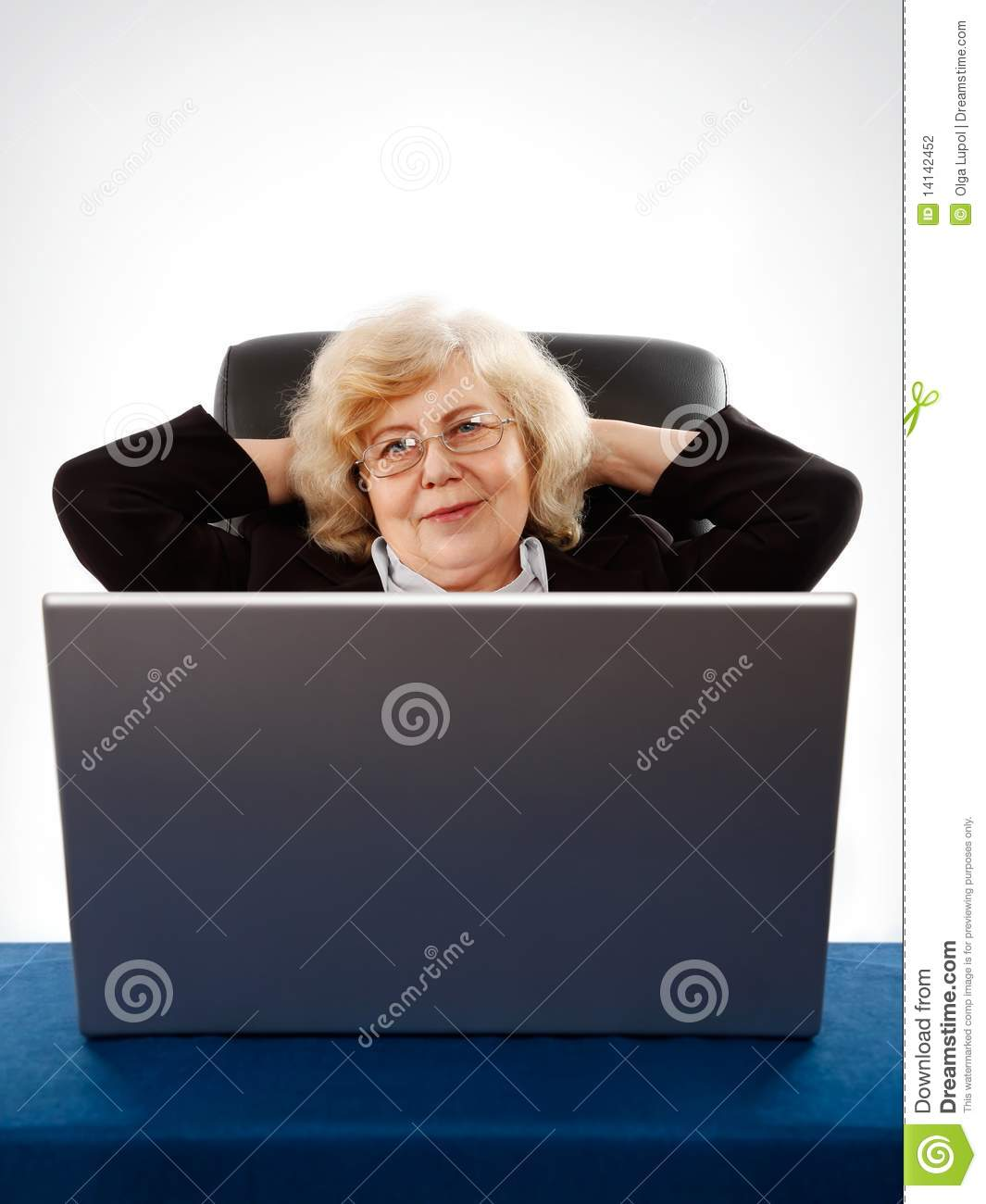Businesswoman sitting in armchair by the laptop stock for Sitting in armchair