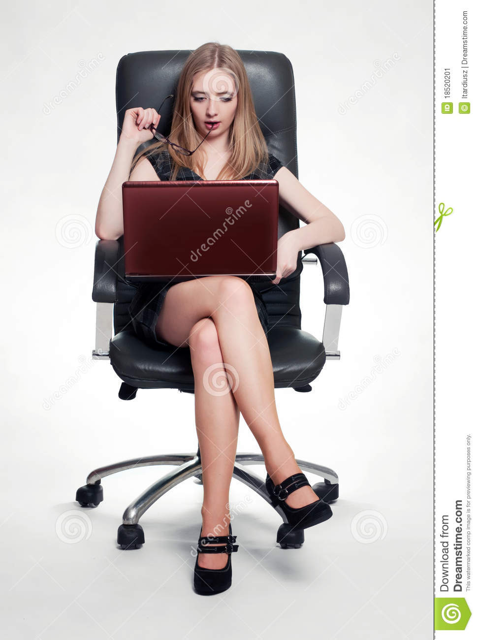 Businesswoman sitting in armchair with laptop stock image for Sitting in armchair