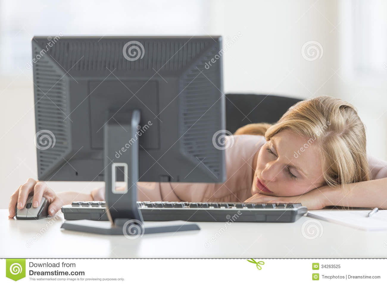 Businesswoman Sleeping At Computer Desk Royalty Free Stock Photo