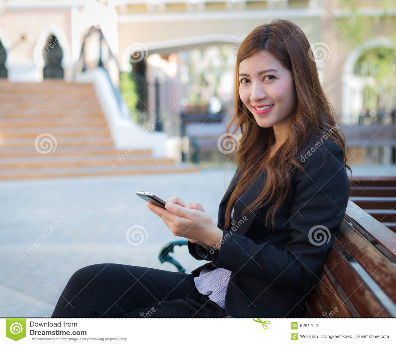 Businesswoman With Smiling Face Sitting On Bench Stock Photo ...