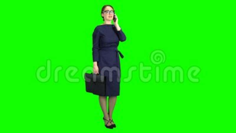 Businesswoman stand and talking on the phone  Green screen