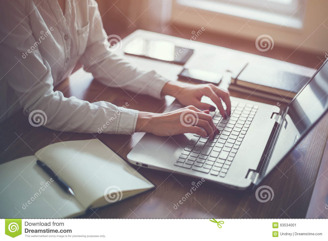 Businesswoman typing on laptop at workplace Woman working in home office hand keyboard.