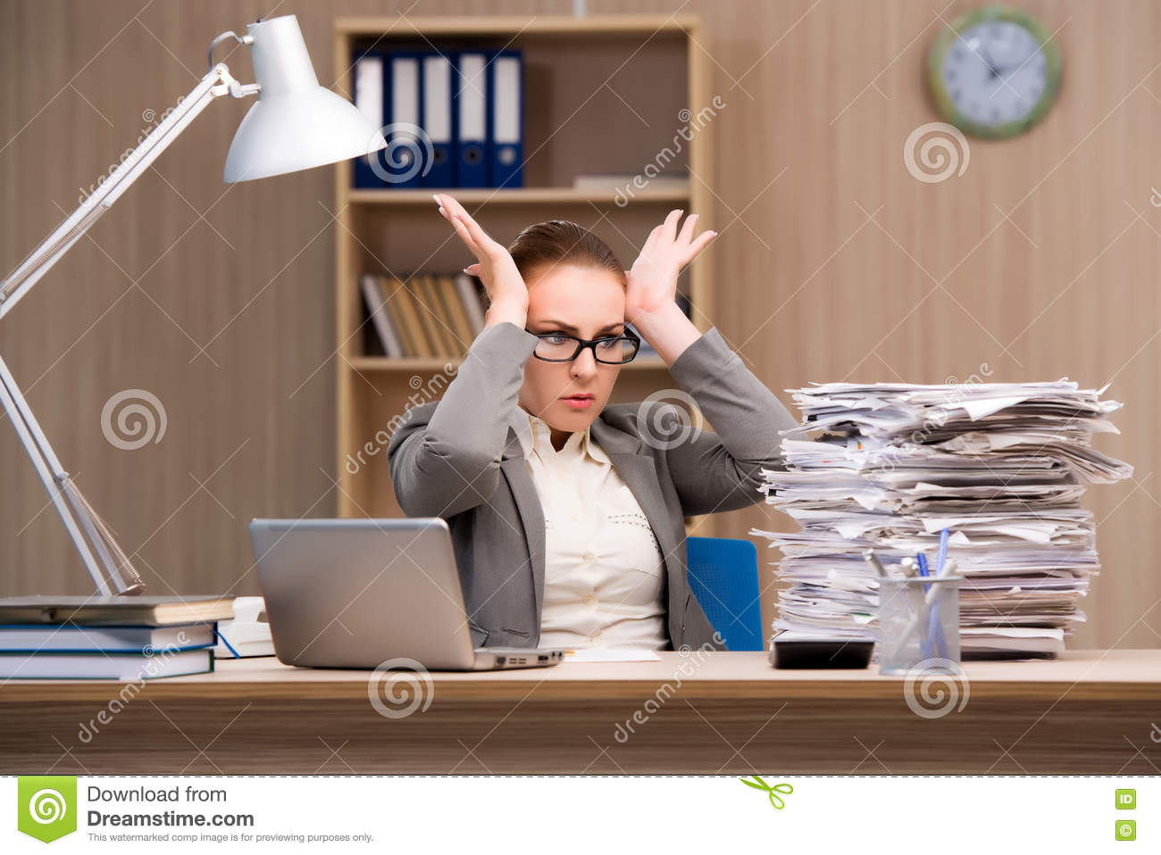 The businesswoman under stress from too much work in the office