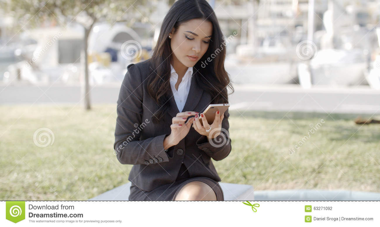 Businesswoman Busy With Phone While Having Coffee Stock
