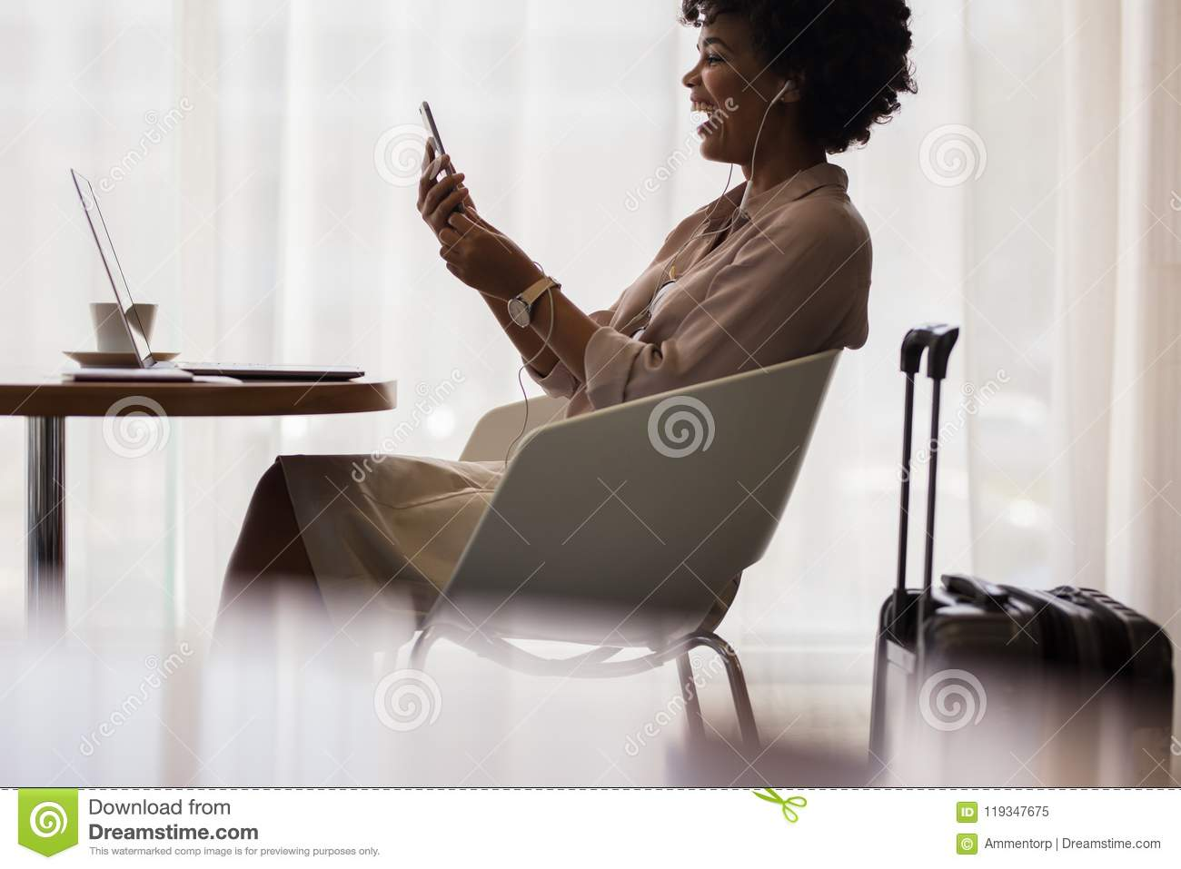 Businesswoman making video call at airport lounge