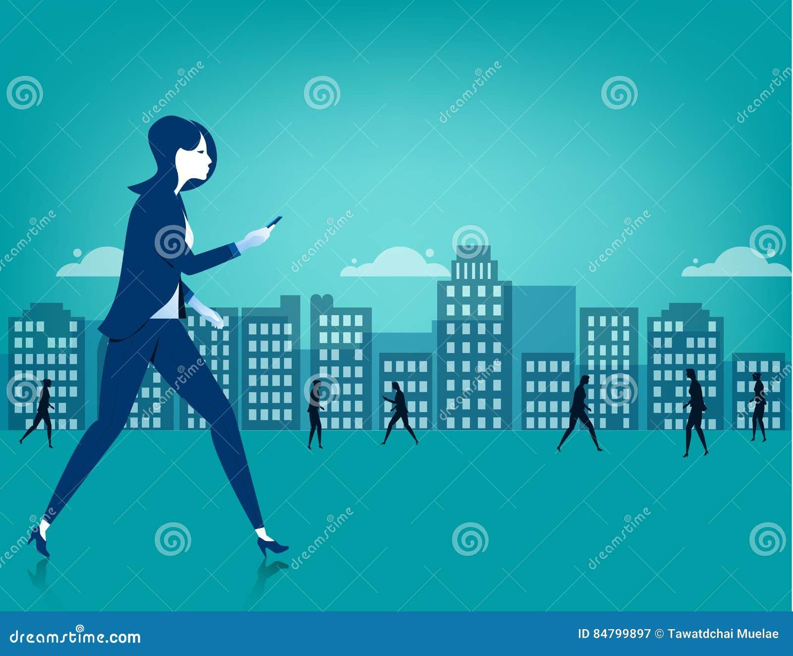 Businesswoman walking on city using a smart phone