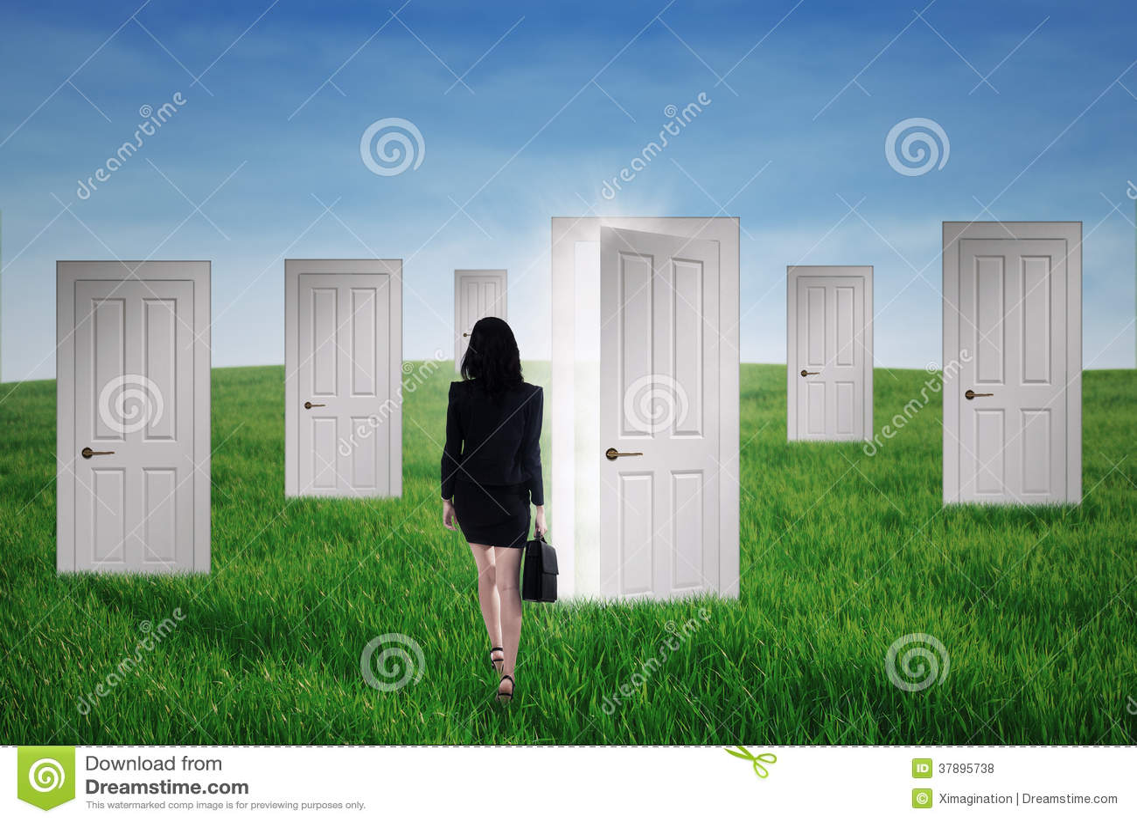 Girl Walks Into Door : Businesswoman walks into opportunity doors royalty free