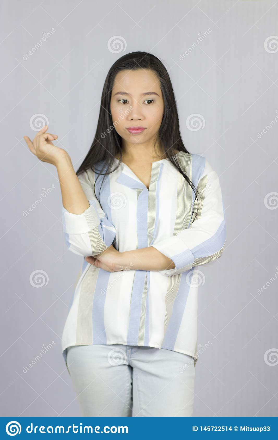 Businesswoman wearing shirt posing smile thinking isolated on gray background