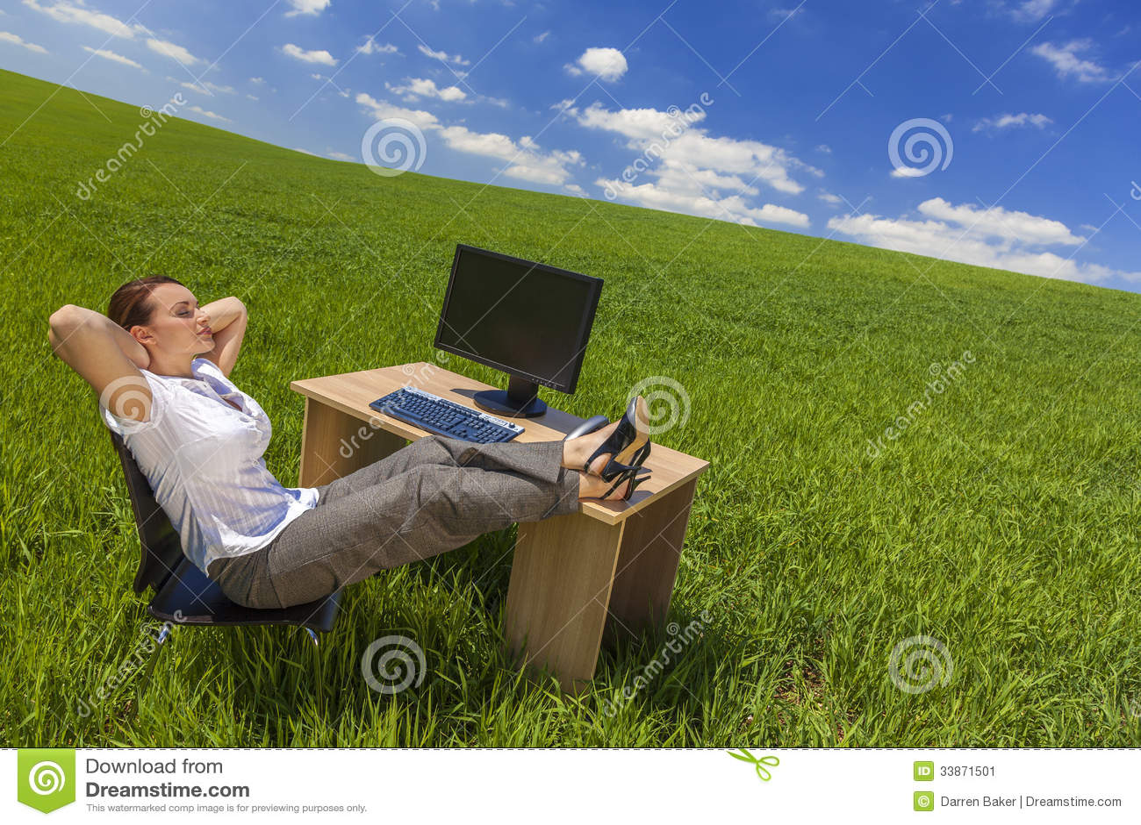 Businesswoman Woman Relaxing at Desk In Green Field