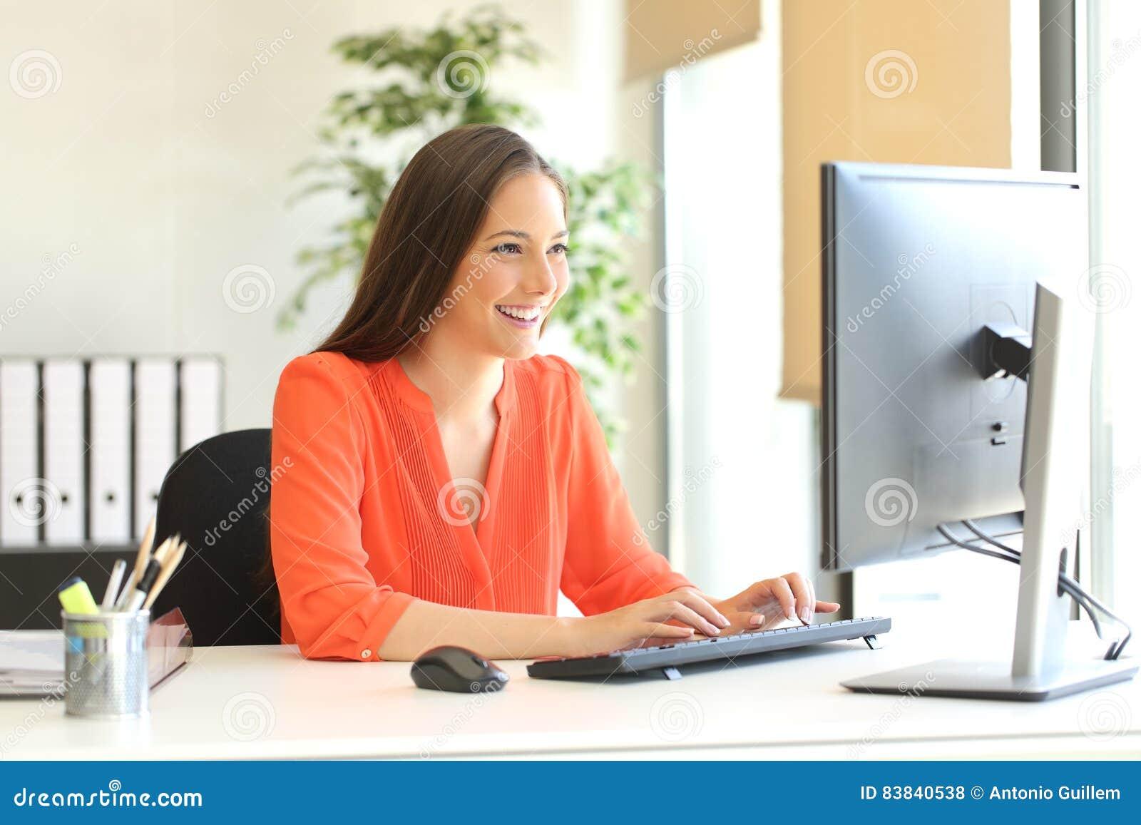 Businesswoman working typing in a desktop computer