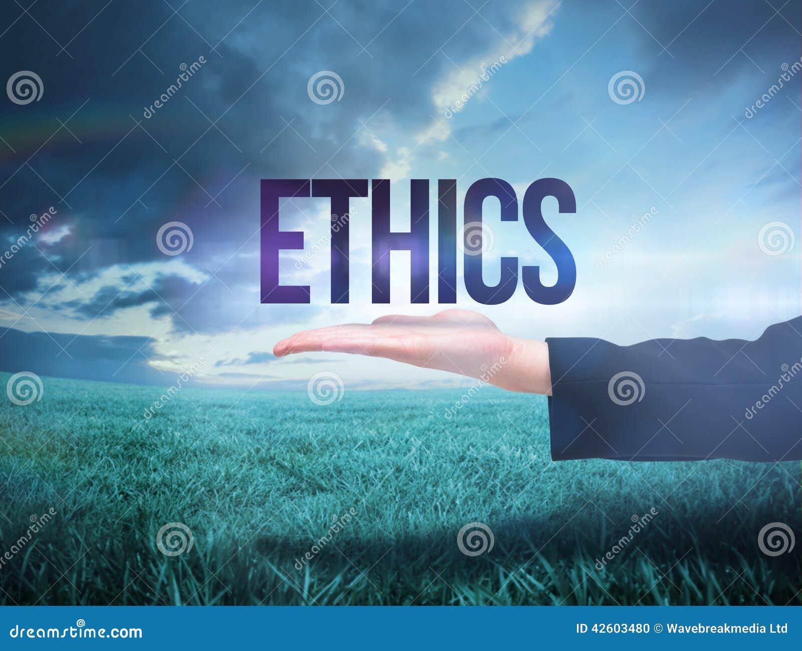 Businesswomans ręka przedstawia słowo etyki