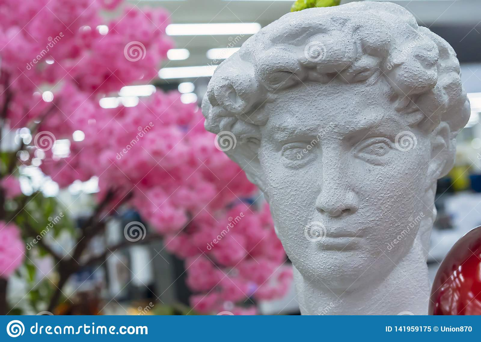 Bust of David by Michelangelo against a background of cherry blossoms