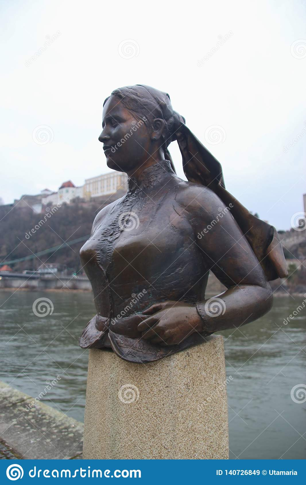 Bust of the poet and landlady Emerenz Meier on the quay of the Danube river in Passau, Germany.