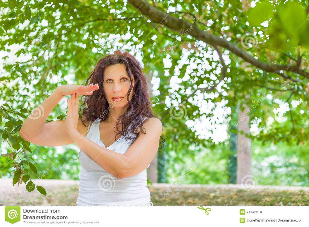 Busty Mature Woman Showing Time Out Gesture