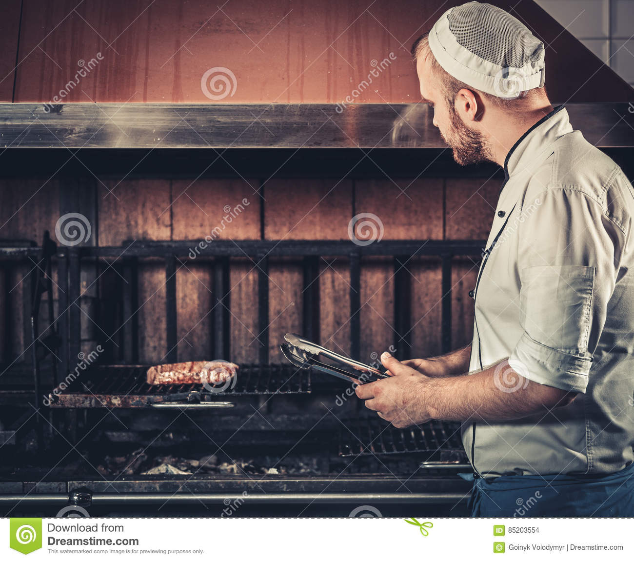 Blue apron restaurant - Busy Chef At Work In The Restaurant Kitchen Stock Images