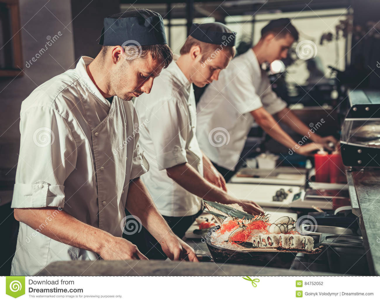 Busy Restaurant Kitchen busy chefs at work in the restaurant kitchen stock photo - image