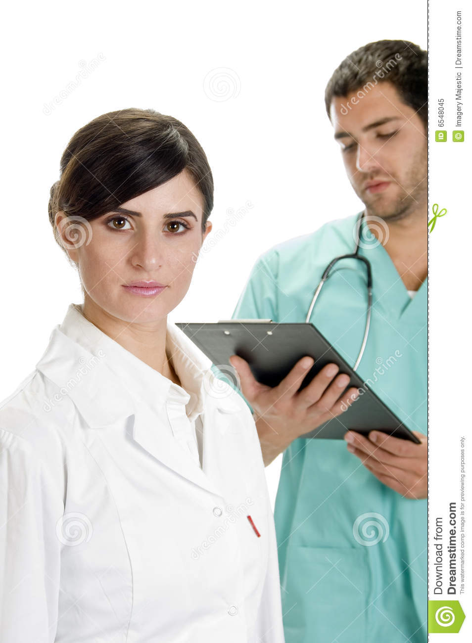 Busy Doctor Writing On Pad With Nurse Royalty Free Stock ...