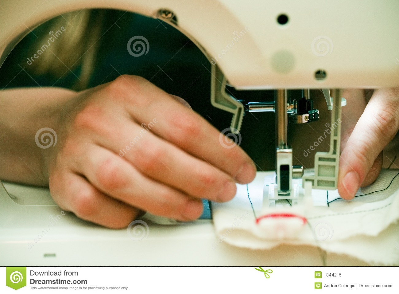 Busy hands at sewing machine.