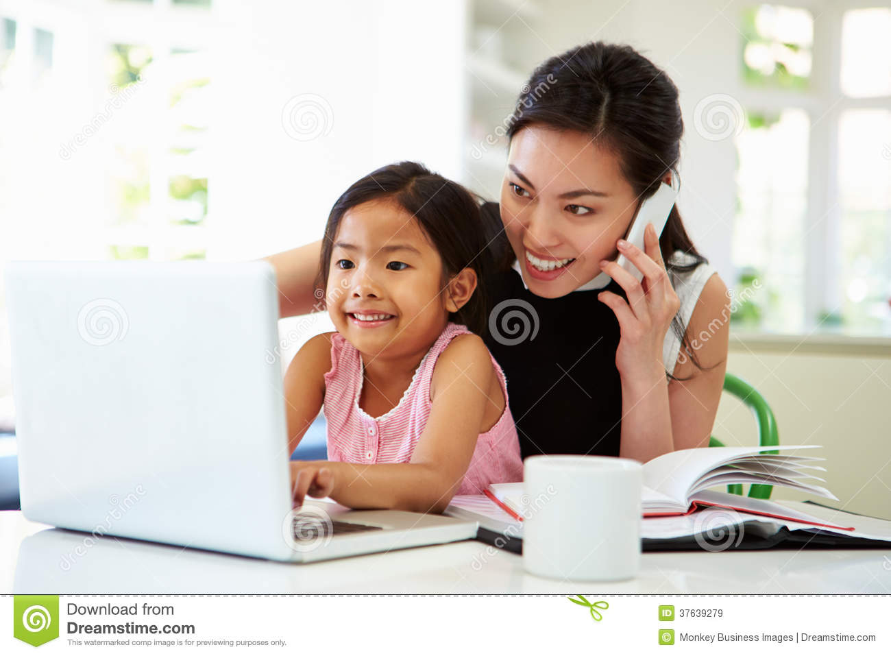 Busy mother working from home with daughter stock image for Mother daughter home plans