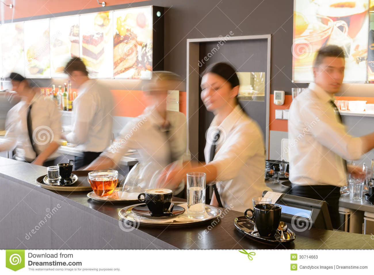 Busy Waiter And Waitresses Working At Bar Stock Image
