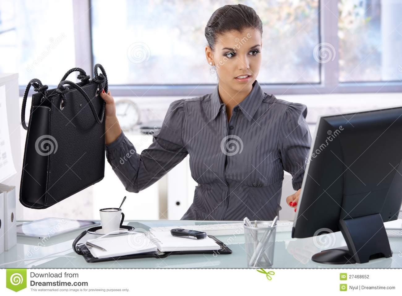 busy woman working in bright office stock photo