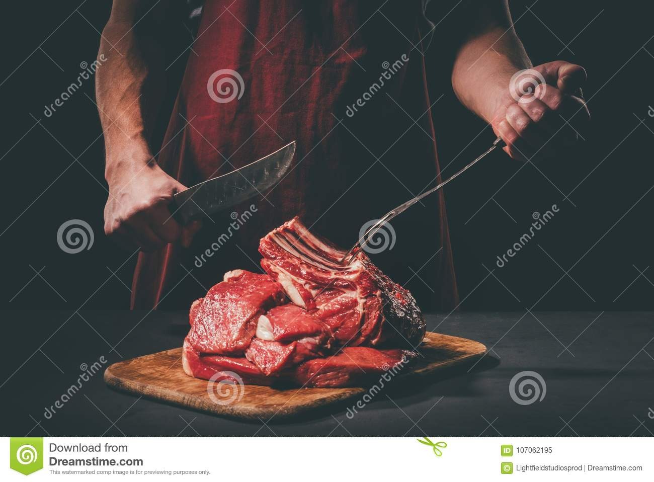 butcher with fork and knife cutting raw meat stock image image of process protein 107062195. Black Bedroom Furniture Sets. Home Design Ideas