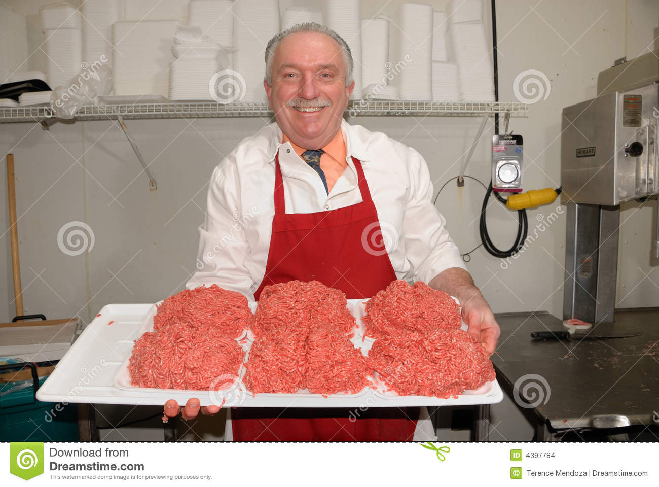Download Butcher Showing Ground Beef Stock Photo - Image of barbeque, butcher: 4397784