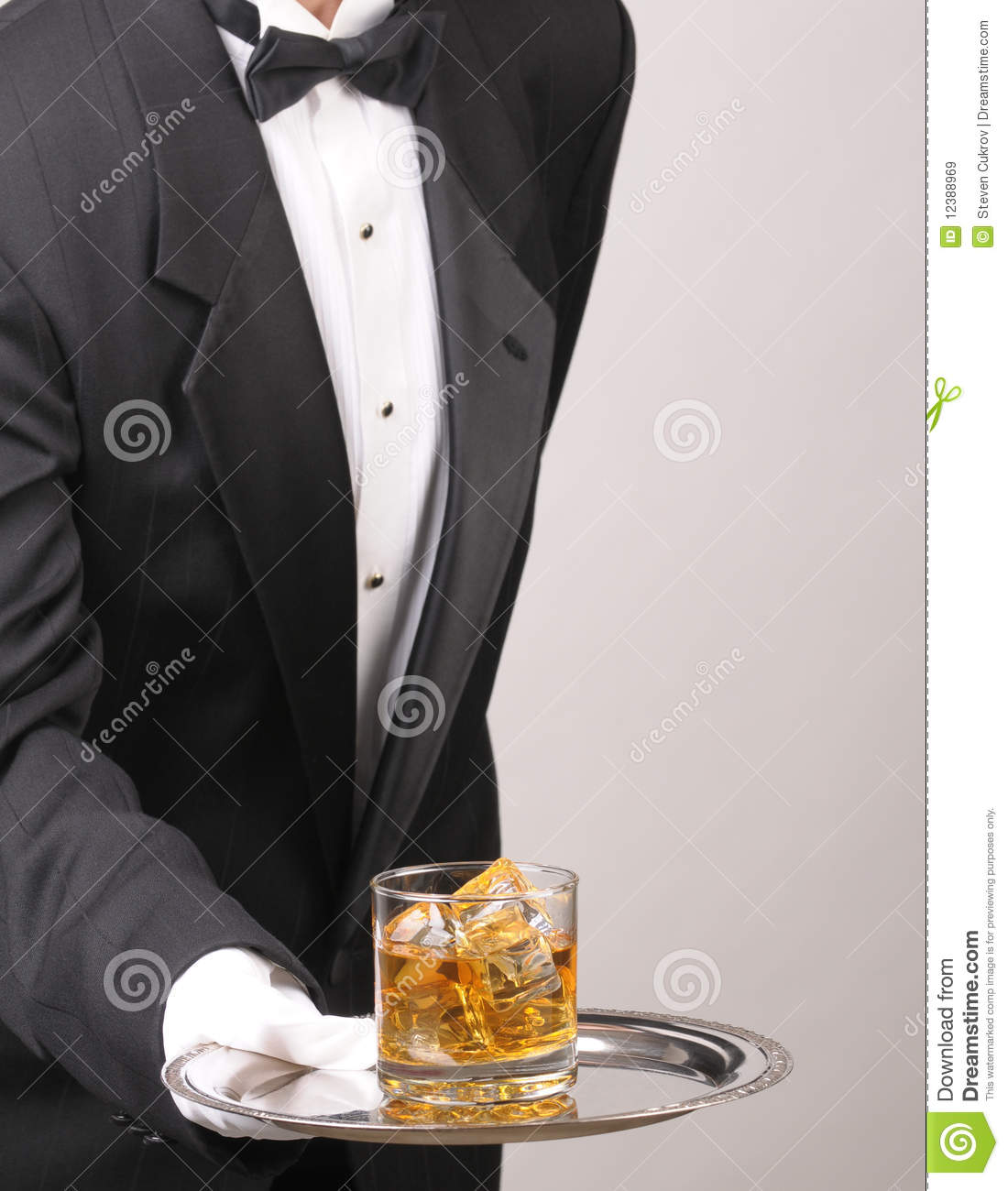 Butler holding Cocktail on tray