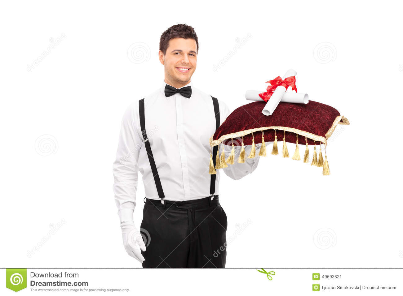Butler holding a red pillow with two University diplomas
