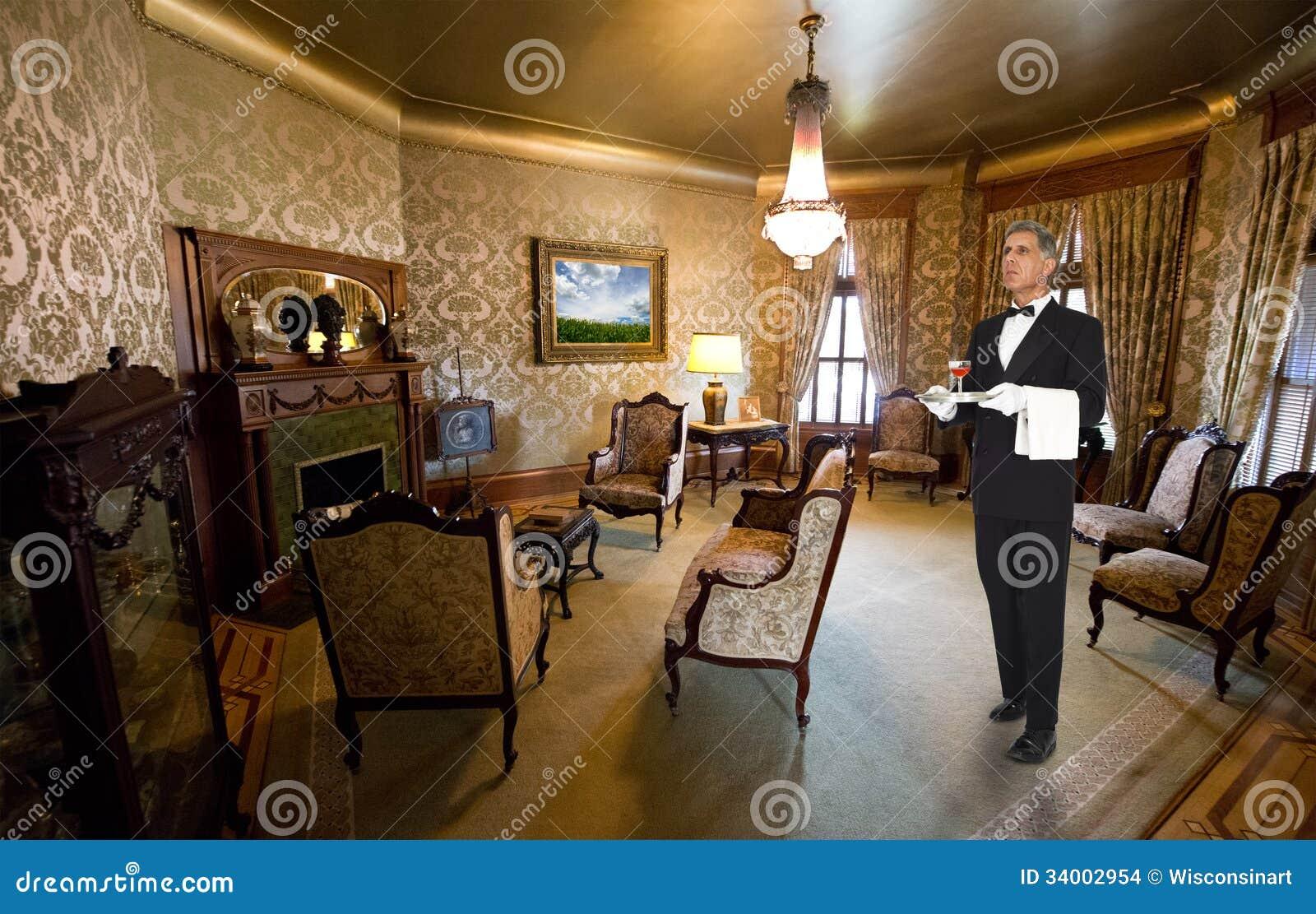 butler ou serveur staff dans le salon victorien de manoir. Black Bedroom Furniture Sets. Home Design Ideas