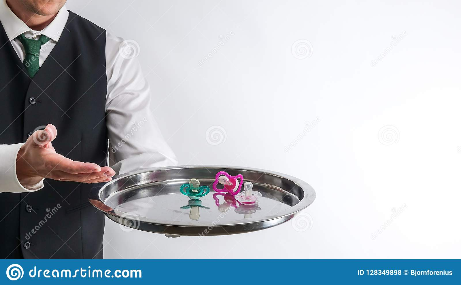 Butler / Waiter Holds A Silver Tray With Pacifiers  Stock