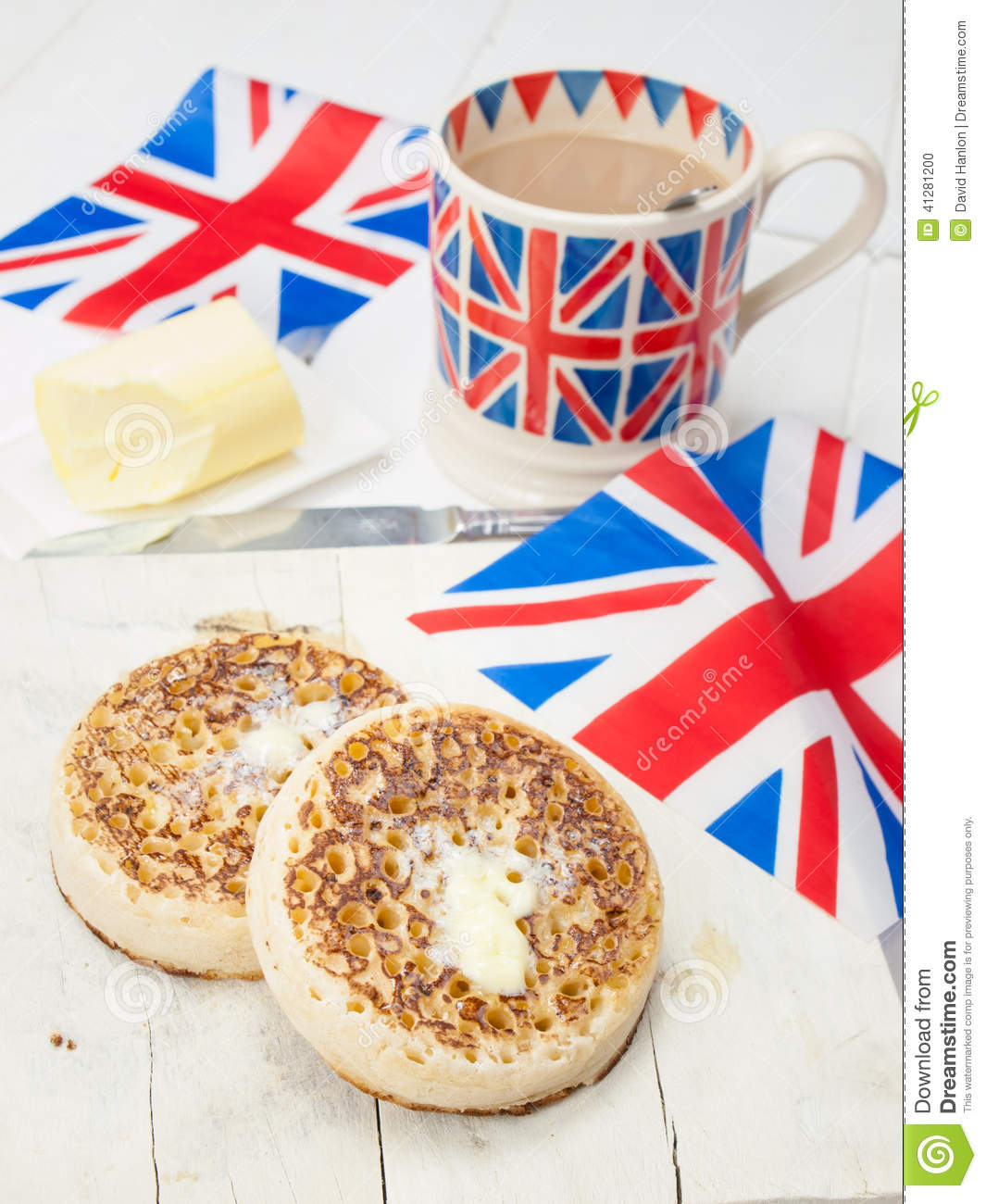 Buttered English Crumpets With Cup Of Tea And Flag In Closeup Stock ...