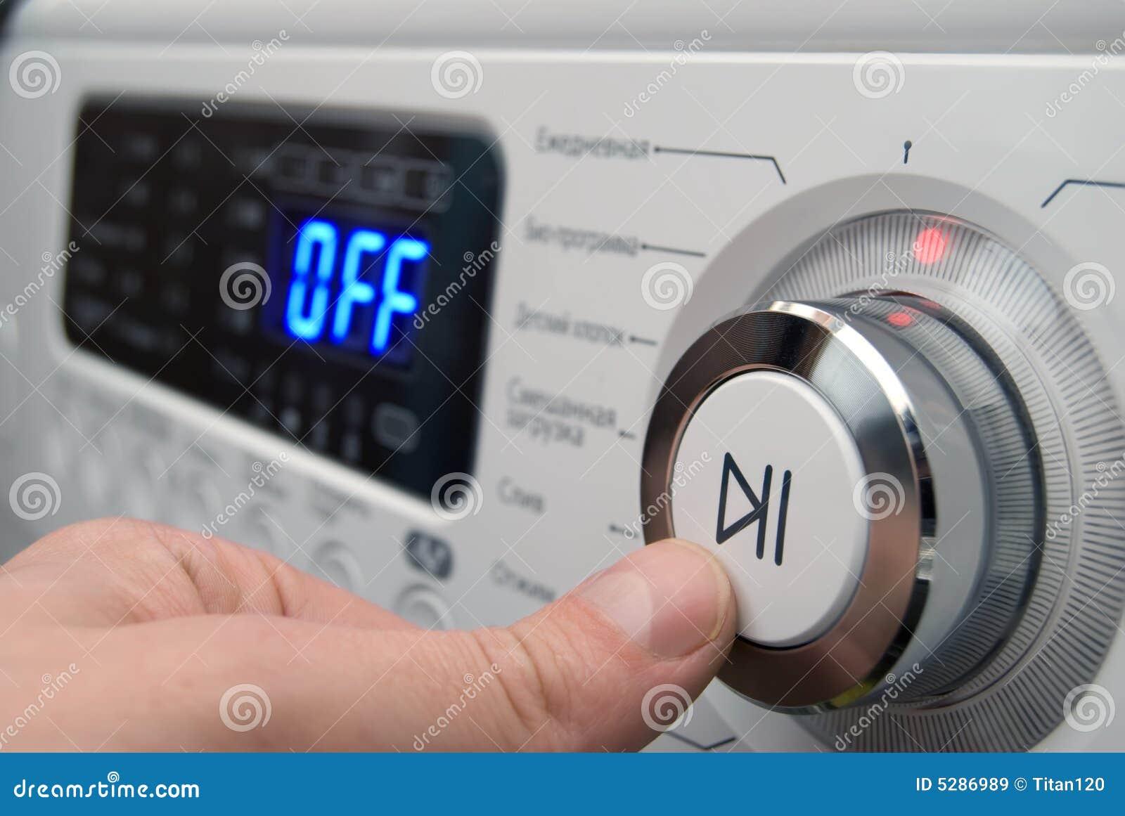 Washing Machine Controls : Button on a control of washing machine panel royalty free
