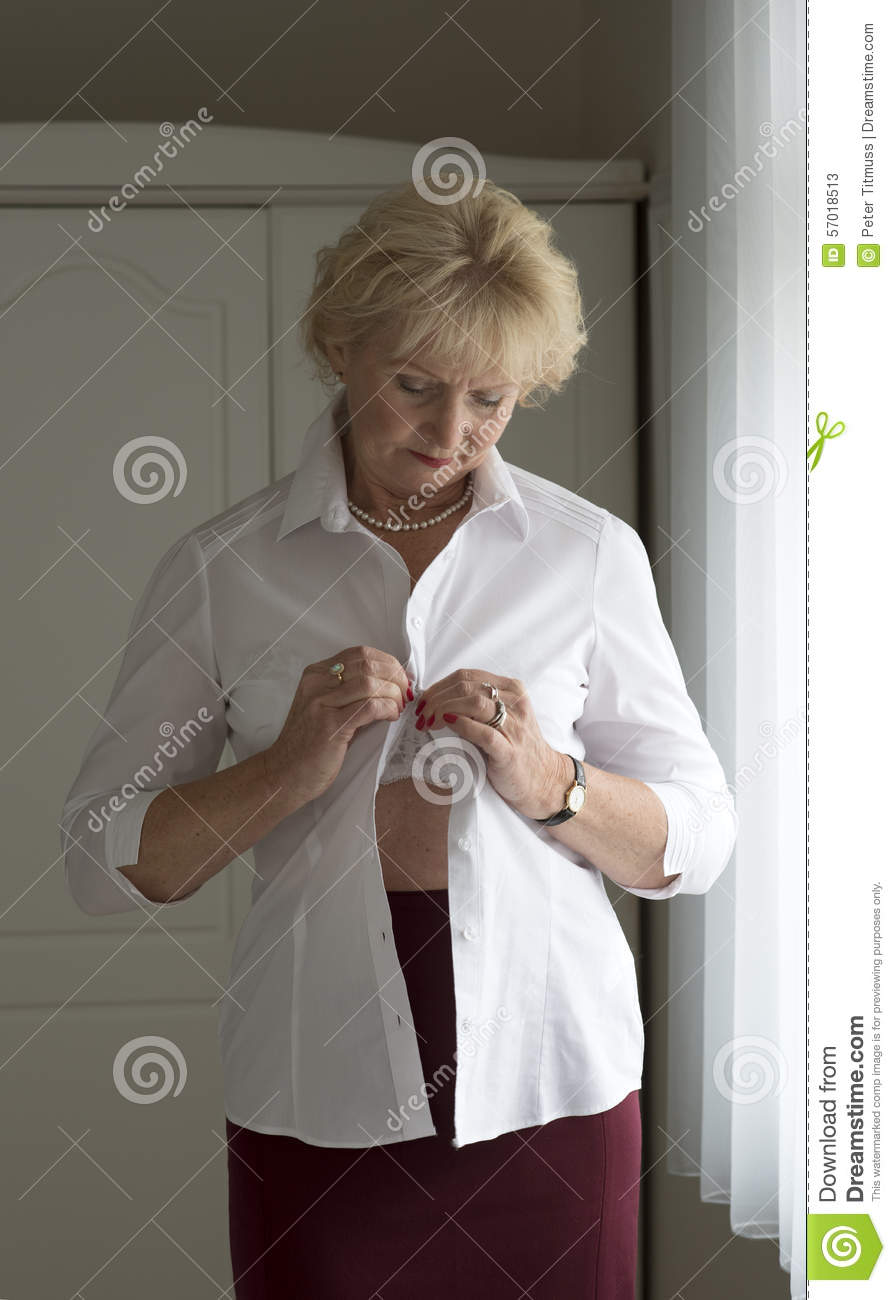 buttoning a white shirt stock photo image 57018513