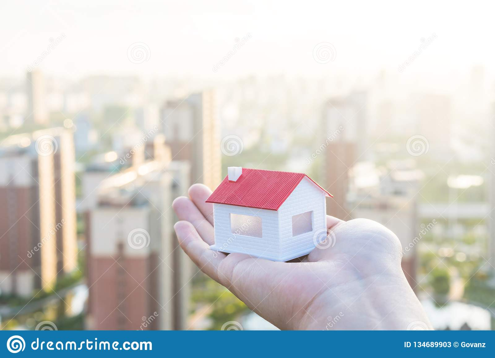 Buy a house, put a model of the house in hand