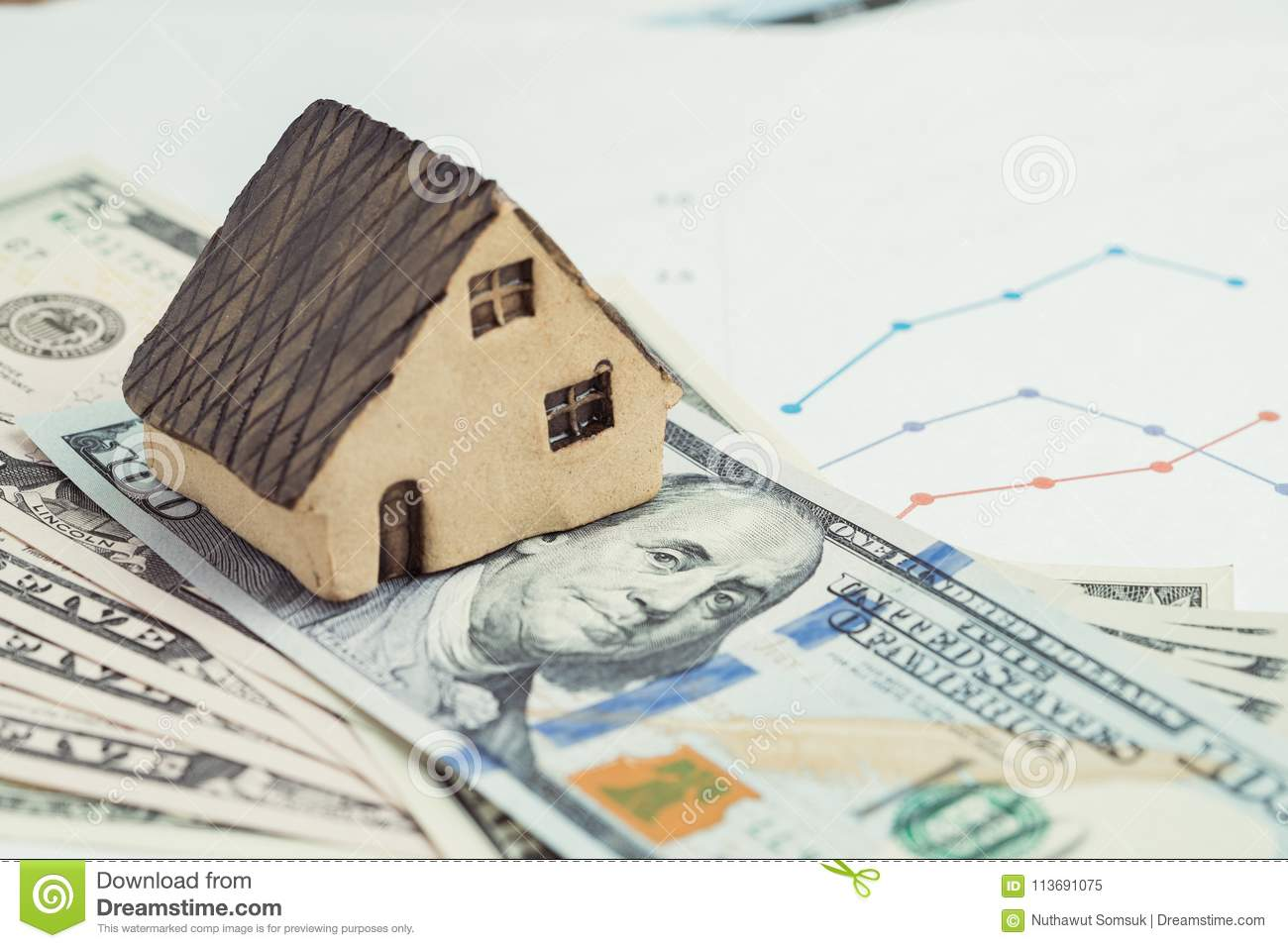 Buy and sell house or real estate, home loan, mortgage and property investment concept, miniature house on pile of US dollar bank